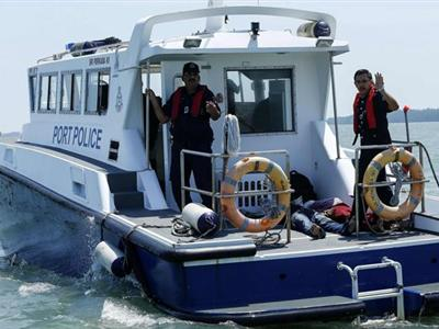 An overloaded boat carrying suspected illegal Indonesian immigrants sank as it left Malaysia's....
